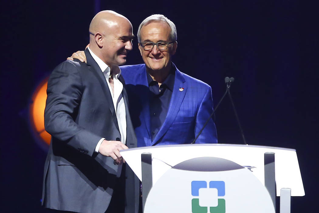 Larry Ruvo, co-founder of Keep Memory Alive, right, welcomes tennis legend Andre Agassi during Keep Memory Alive's 21st annual Power of Love gala at the MGM Grand Garden Arena in Henderson on Thur ...