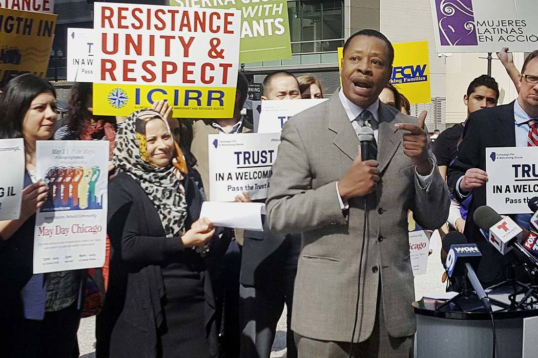 Pastor Don Taylor, of a suburban Chicago organizing group, speaks to immigrant rights advocates in downtown Chicago. The advocates plan to march in a May 1 rally in Chicago. (Sophia Tareen/AP)
