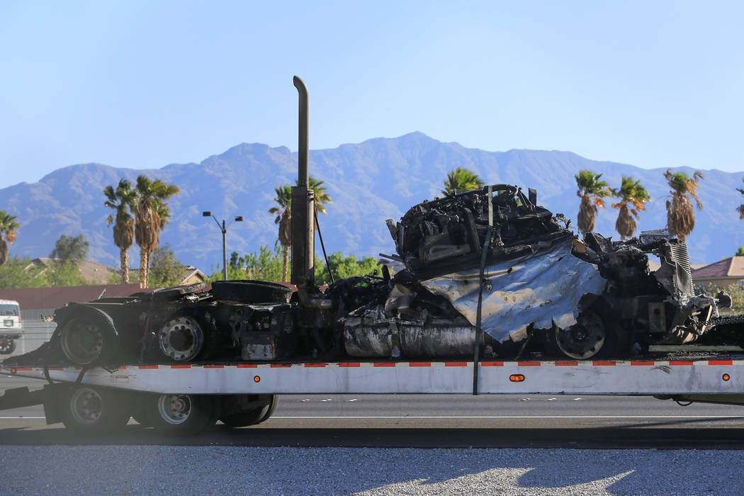 The remains of a semi trailer that caught on fire sit on a trailer on southbound I-15 south of the Durango Drive exit in Las Vegas on Friday, April 28, 2017. Brett Le Blanc Las Vegas Review-Journa ...