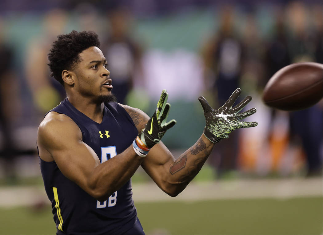 Ohio State defensive back Gareon Conley runs a drill at the NFL football scouting combine Monday, March 6, 2017, in Indianapolis. (AP Photo/David J. Phillip)