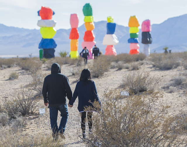 Lexus Estabillo, left, holds hands with Kayla Perez as they walk towards the Seven Magic Mountains art project  on Monday, Jan. 30, 2017, near Jean Dry Lake, Nev. (Benjamin Hager/Las Vegas Review- ...