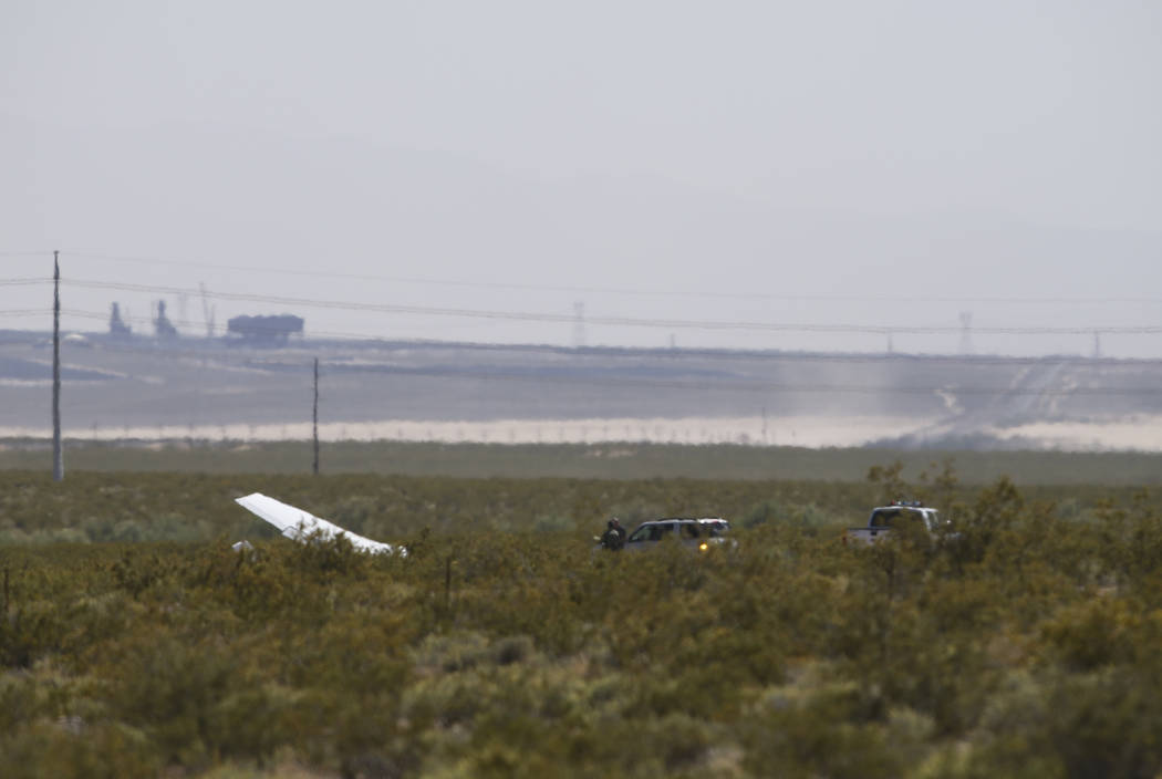 Emergency personnel respond to the scene of a downed plane at Jean Sport Aviation Center in Jean on Friday, April 28, 2017. Chase Stevens Las Vegas Review-Journal @csstevensphoto