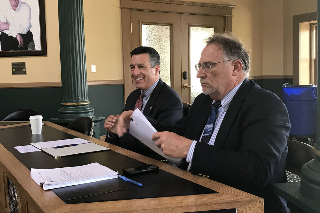 Gov. Brian Sandoval, left, with Chief of Staff Mike Willden, talk with reporters at the Capitol on Friday, April 28, 2017, on meetings the governor had with Trump administration officials this wee ...