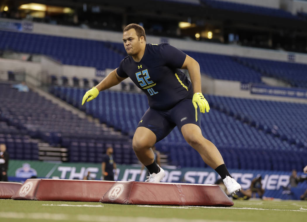 UCLA defensive lineman Eddie Vanderdoes runs a drill at the NFL football scouting combine Sunday, March 5, 2017, in Indianapolis. (AP Photo/David J. Phillip)