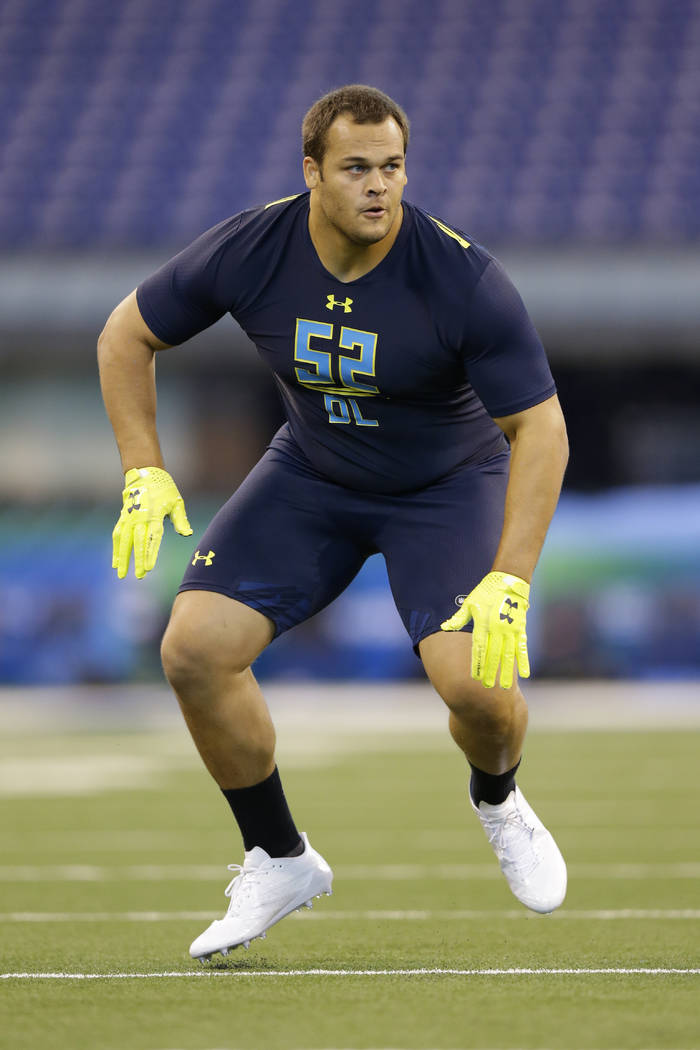 UCLA defensive lineman Eddie Vanderdoes runs a drill at the NFL football scouting combine in Indianapolis, Sunday, March 5, 2017. (AP Photo/Michael Conroy)