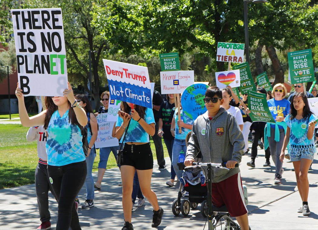 The crowd marches at the UNLV campus as a part of the national People's Climate Marches, Saturday, April 29, 2017. Gabriella Benavidez Las Vegas Review-Journal @gabbydeebee