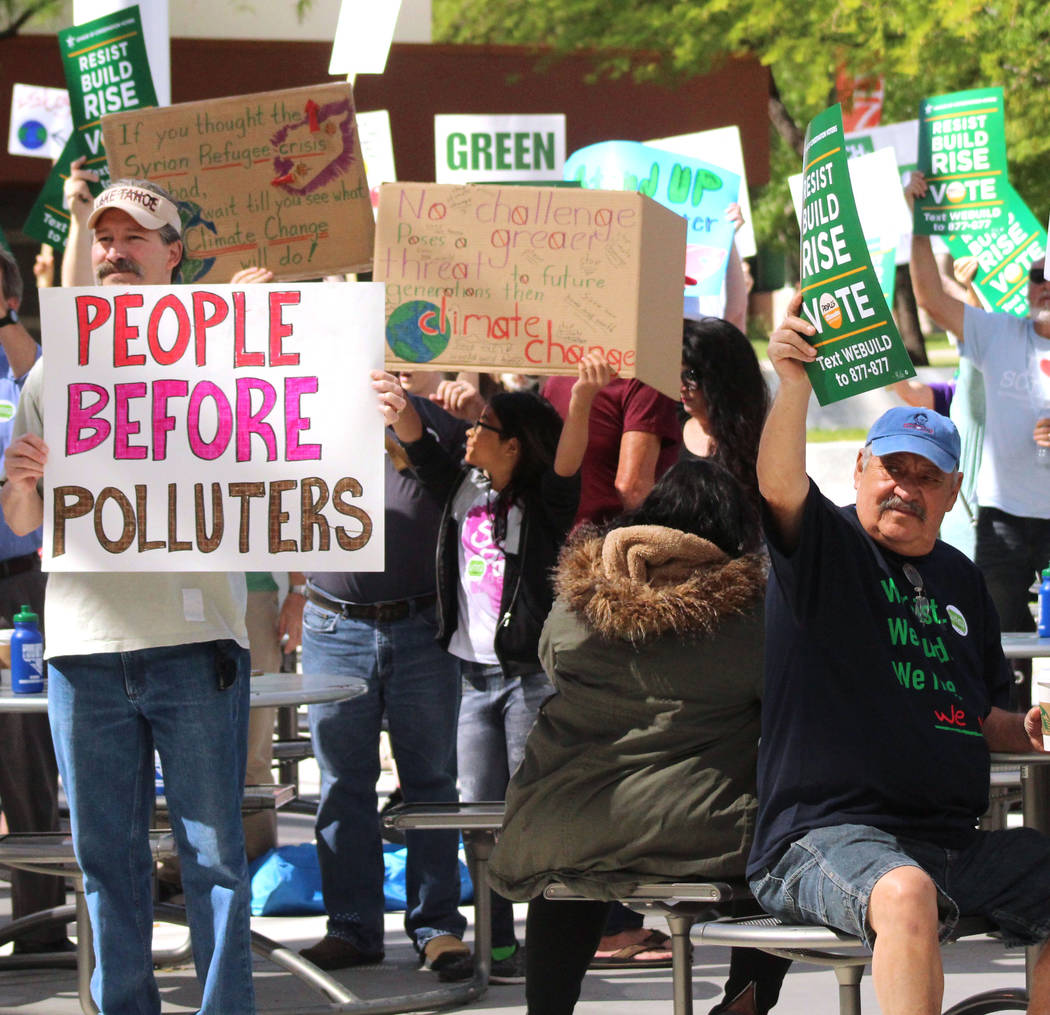 The crowd hold up their signs before the People's Climate March at UNLV gets underway, Saturday, April 29, 2017. Gabriella Benavidez Las Vegas Review-Journal @gabbydeebee