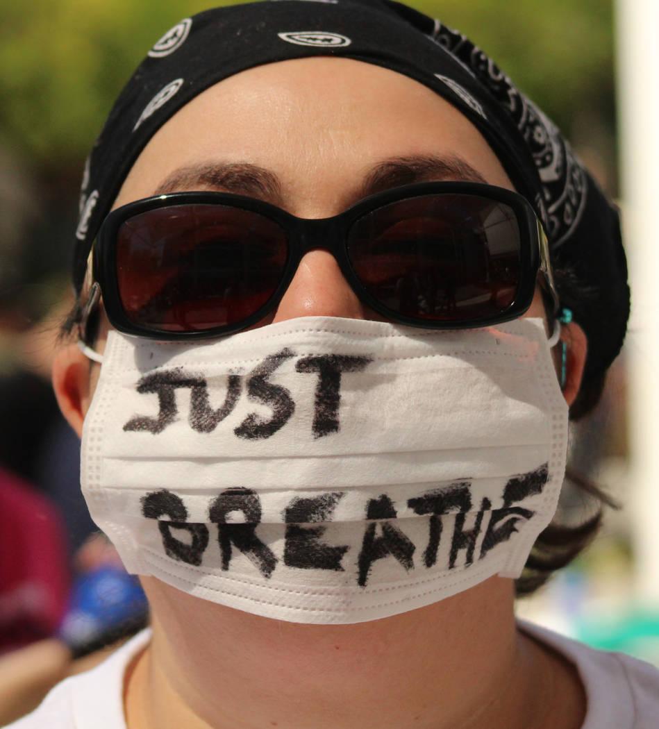 Las Vegas native Kenia Leon, who has respiratory problems, wears a mask at the People's Climate March at UNLV, Saturday, April 29, 2017. Gabriella Benavidez Las Vegas Review-Journal @gabbydeebee