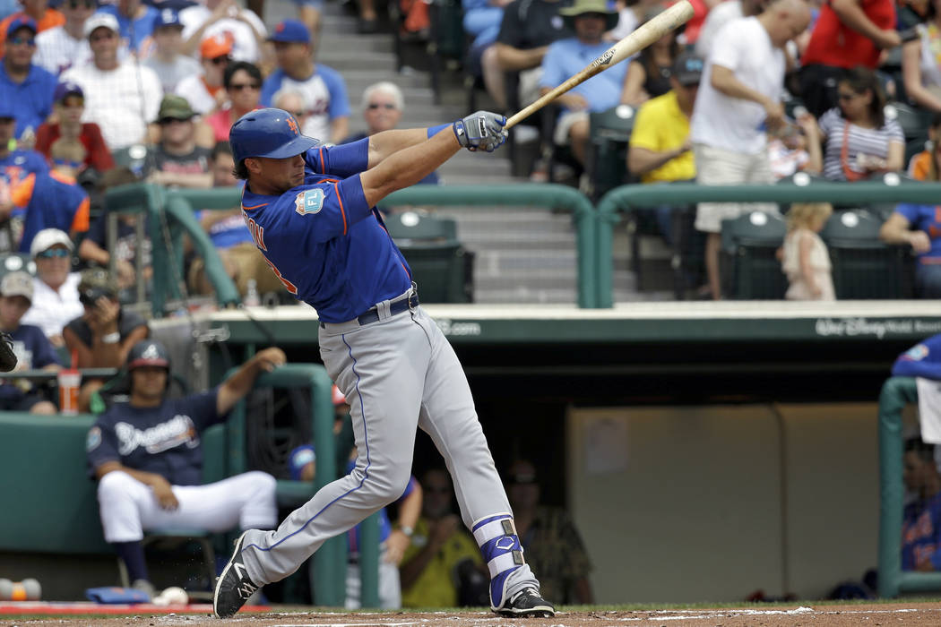 New York Mets' Travis Taijeron bats against the Atlanta Braves in a spring training baseball game, Saturday, March 26, 2016, in Kissimmee, Fla. (AP Photo/John Raoux)