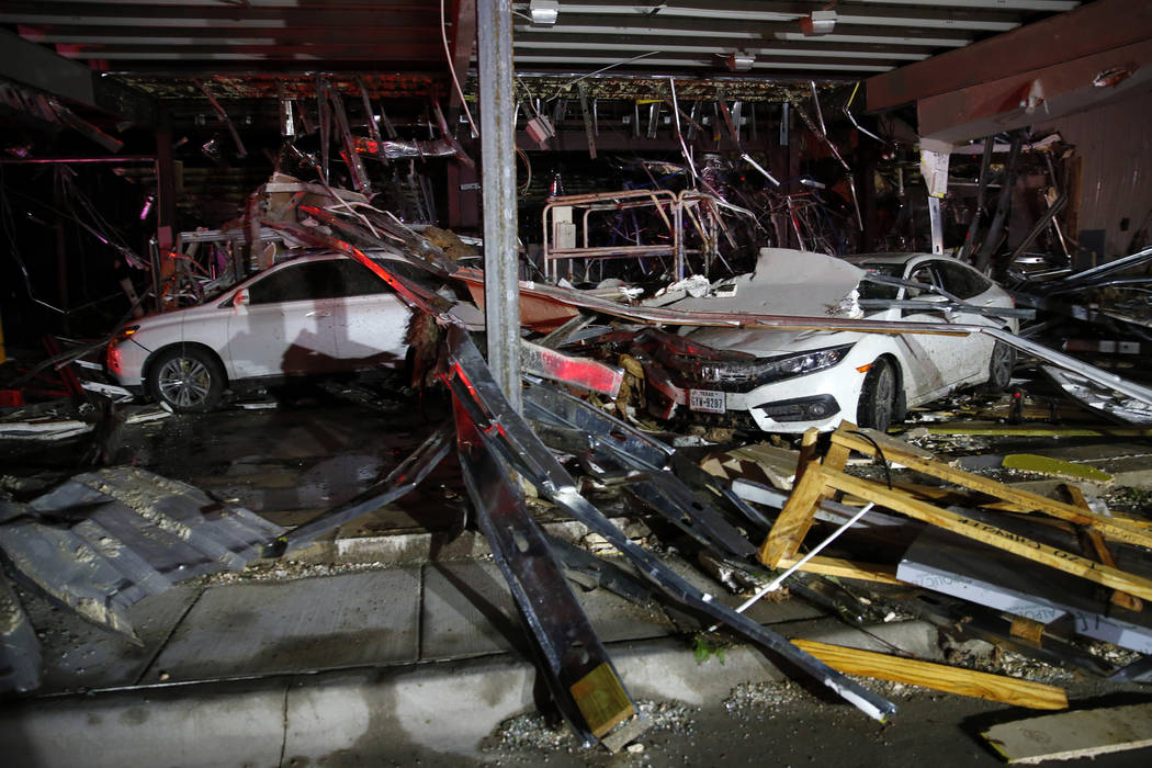 Cars and trucks are damaged as the walls blew out of the I-20 Dodge dealership after a tornado hit near Canton, Texas, Saturday, April 29, 2017. The National Weather Service says at least one torn ...
