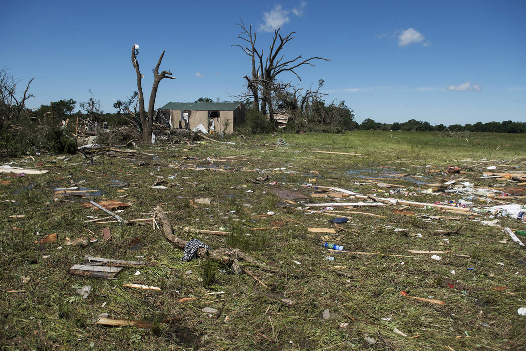 Debris lies on the ground in Canton, Texas on Sunday, April 30, 2017. Severe storms including tornadoes swept through several small towns in East Texas, killing several people, and leaving a trail ...