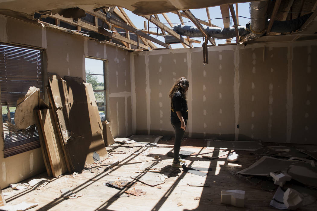 Stephanie Quezada looks at the damage to the second floor of her father's church, Primera Iglesia Bautista, in Canton, Texas, Sunday, April 30, 2017. Severe storms including tornadoes swept throug ...
