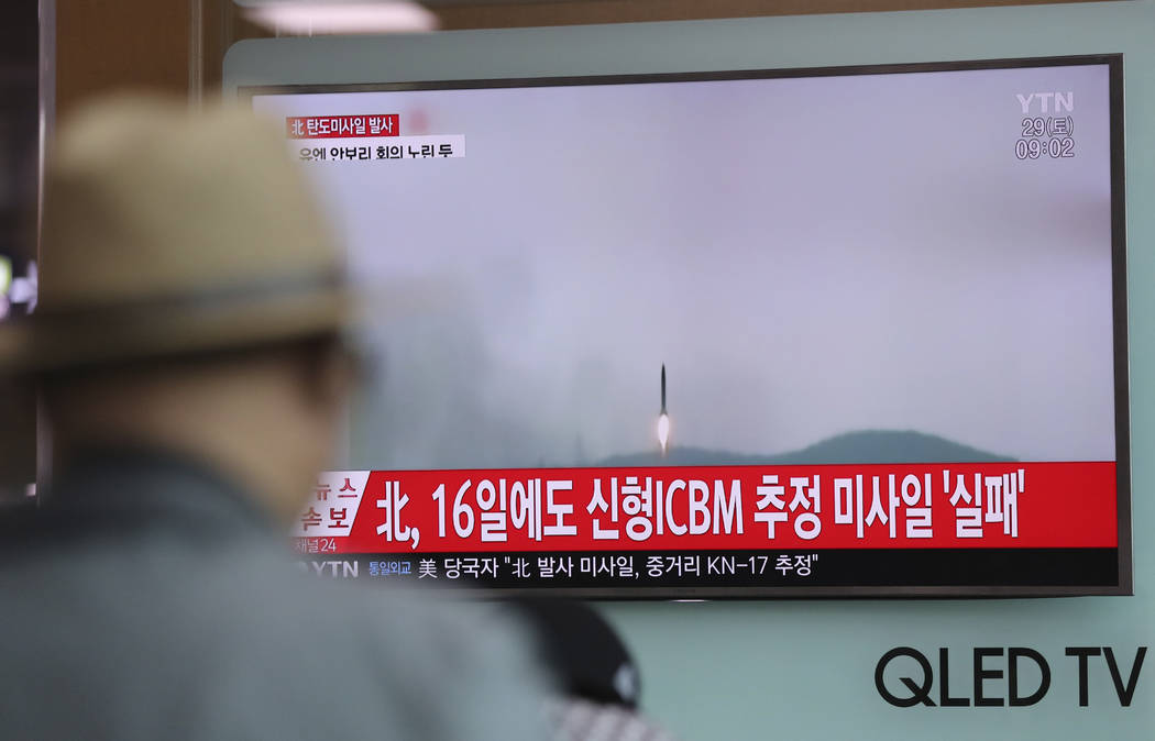 A man watches a TV news program reporting about North Korea's missile firing with a file footage, at Seoul Train Station in Seoul, South Korea, Saturday, April 29, 2017. The letters on top left re ...