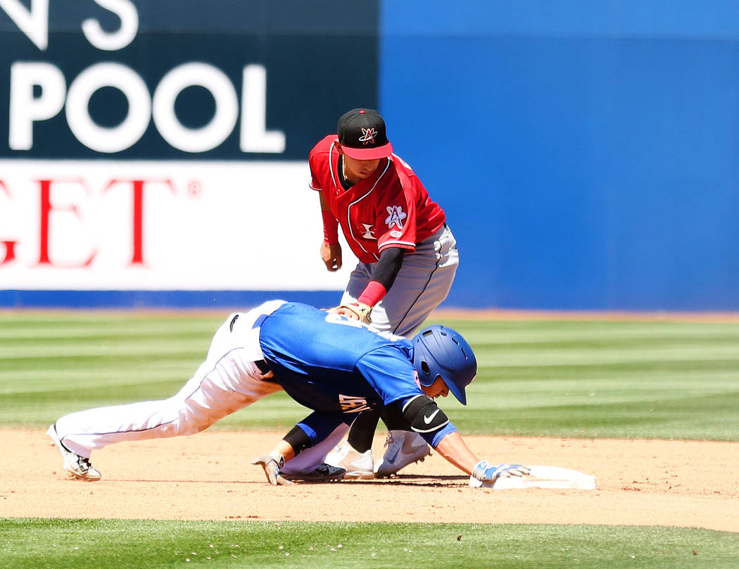 Las Vegas 51s Arnaldo Berrios (35) successfully makes it to second base as Albuquerque Isotopes Daniel Castro tries to tag out in the seventh inning at Cashman Field in Las Vegas, Sunday, April 30 ...