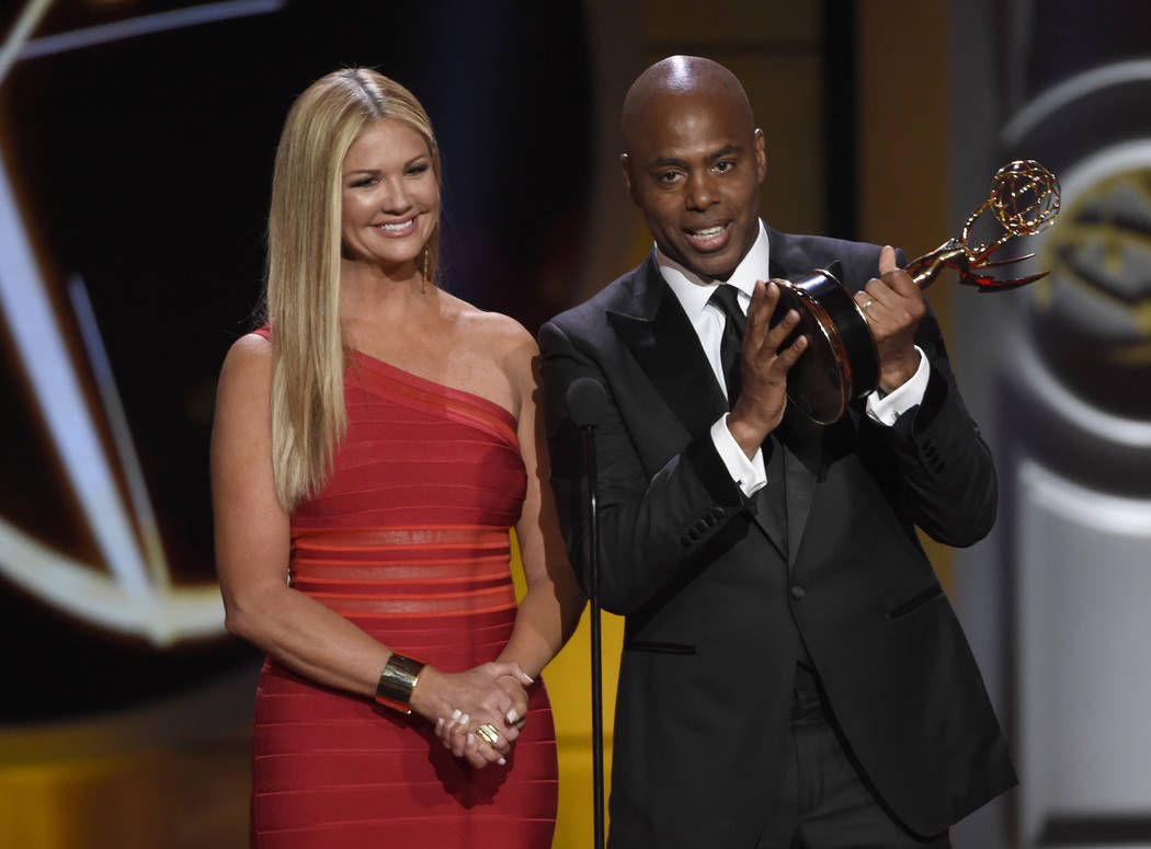 "Nancy O'Dell, left, and Kevin Frazier accept the award for outstanding entertainment news program for ""Entertainment Tonight"" at the 44th annual Daytime Emmy Awards at the Pasade ..."