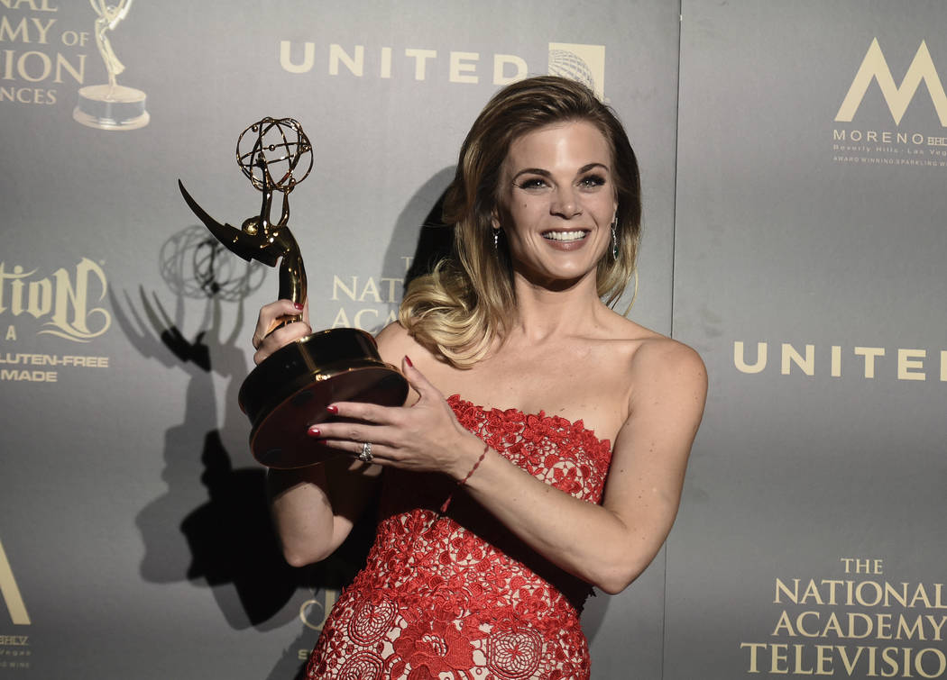 "Gina Tognoni, winner of the award for outstanding lead actress in a drama series for ""The Young and the Restless,"" poses in the press room at the 44th annual Daytime Emmy Awards  ..."