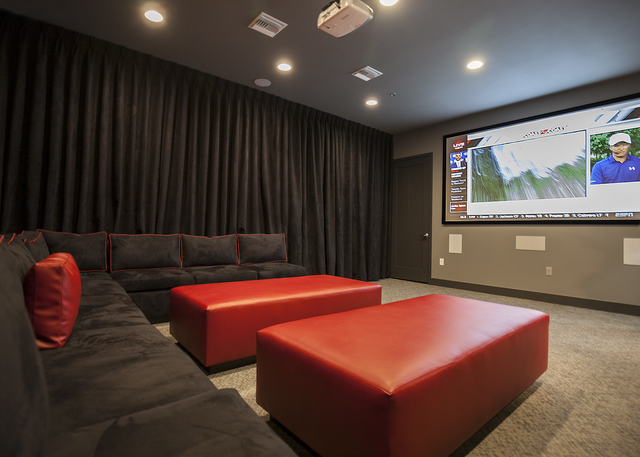 Residents can watch movies, sports events or business presentations in the media room. (ELKE COTE-RJREALESTATE.VEGAS)