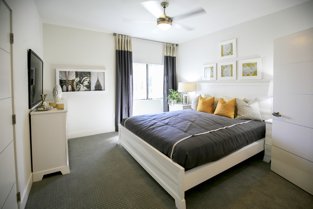 Residents have the option of grey laminate flooring or carpet and each unit has a laundry room and comes with a 50-inch smart television. (ELKE COTE-RJREALESTATE.VEGAS)
