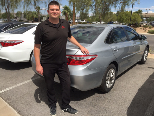 COURTESTY Kody Grady, Findlay Toyota's new car manager, shows off the 2017 Camry at the dealership located in the Valley Automall in Henderson.