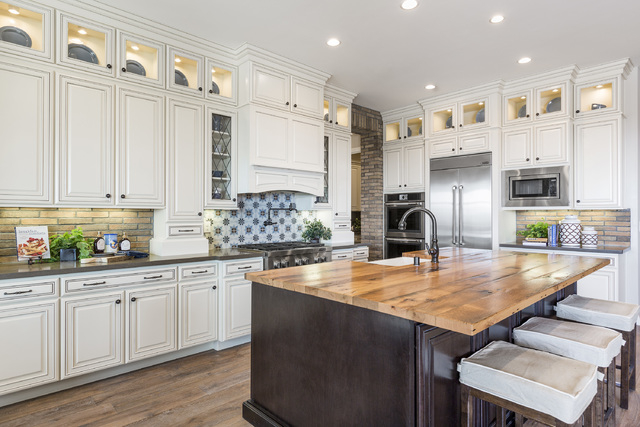 DAVID REISMAN/RJRealEstate.Vegas A kitchen of one of the three new home model in Toll Brothers' Los Altos showcases a central island with seating and white cabinets.