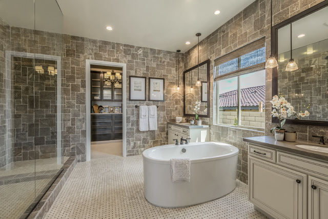 DAVID REISMAN/RJRealEstate.Vegas The luxury home's master bath feature a soaking tub.