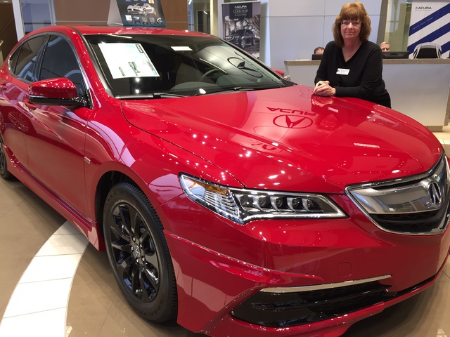 COURTESY Longtime Acura sales consultant Mary Weisbrod shows off the 2017 Acura TLX at Findlay Acura in the Valley Automall.