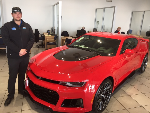 COURTESY Findlay Chevrolet sales and leasing consultant Steven McGee shows off the 2017 Camaro ZL1 at the dealership situated in the southwest valley.