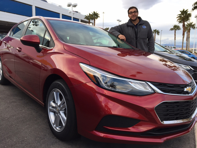 COURTESY Findlay Chevrolet sales consultant and floor manager Maxwell Eichbauer poses with the 2017 turbo-powered Chevrolet Cruze at the dealership situated at the 215 Beltway and South Rainbow Bo ...