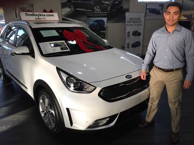 COURTESY Findlay Kia sales consultant George Lucas Tadeo is seen with the 2017 Kia Niro Crossover at the dealership situated at 5325 W. Sahara Ave.
