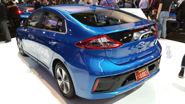 """COURTESY STAN HANEL This Hyundai Ioniq Electric car has been adapted to test autonomous driving software and hardware. Note the red Nevada license plate with sideways """"infinity"""" symbol to denote a ..."""