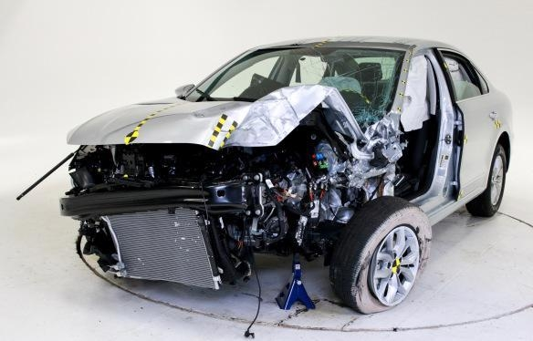 COURTESY Carmakers rarely show us smashed product, but VW's point is that its 2016 Passat got a top rating from the Insurance Institute for Highway Safety in the problematic Small Overlap Front  ...