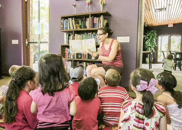 Barbra Konrad, like many U.S. master-planned community residents, uses social media to offer events, such as this storytime hour. (Elke Cote/RJRealEstate.Vegas)