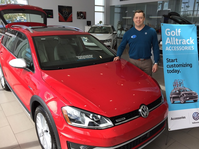 COURTESY Findlay North Volkswagen General Manager Doug Fleming poses with the 2017 Volkswagen Golf Alltrack at Findlay North Volkswagen in the northwest valley.