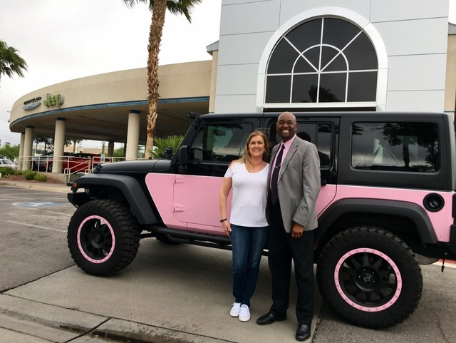 COURTESY Bobbie Nemetz and Chapman Warm Springs general manager, Lawrence Ennis, stand in front of her pink and black Jeep Wrangler at the Chapman Chrysler Jeep location at the Valley Automall.