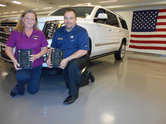 COURTESY Findlay Cadillac sales consultants Deb Topham and Jason Clouse were named recipients of the prestigious Cadillac Crest Club award. Both are now five-time winners of the award.