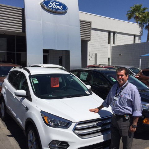 COURTESY Friendly Ford sales consultant Rafael DeLeon shows off the new line of 2017 Escape sport utility vehicles at the award-winning dealership situated at 660 N. Decatur Blvd.