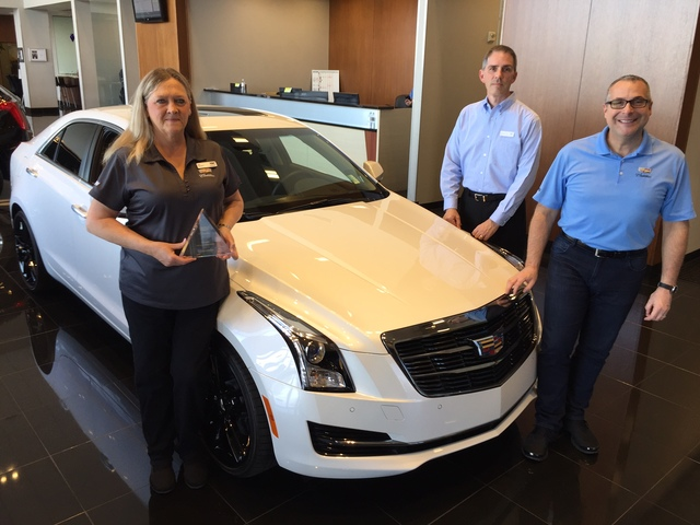 COURTESY Findlay Cadillac sales consultant Deb Topham, recently named the top salesperson for Cadillac stores in Nevada, is seen with Cadillac district sales manager Ronald McTavish and Findlay Ca ...