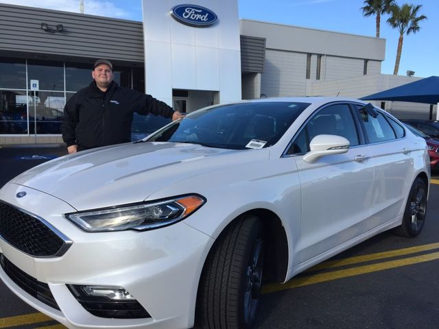 COURTESY Friendly Ford sales and leasing consultant Kevin Speakman is seen with the 2017 Ford Fusion Sport at the dealership situated at 660 N. Decatur Blvd.