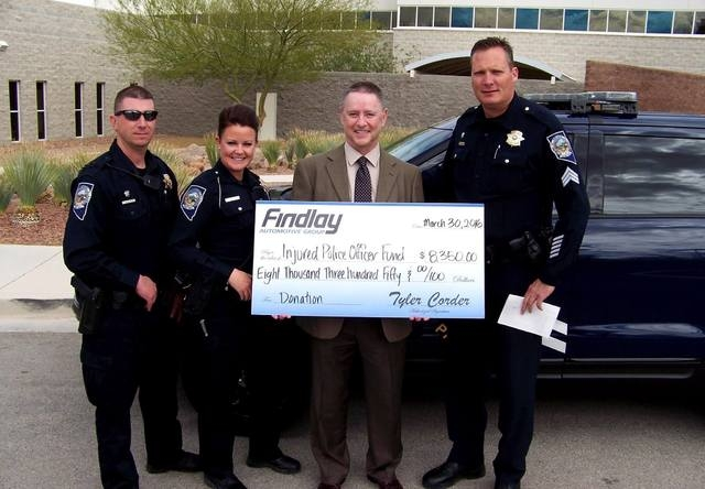 COURTESY Findlay Automotive Group combined with prominent Las Vegas business executive Phil Maloof recently to present a donation of $8,350 to the Injured Police Officers Fund. From left, Trooper  ...