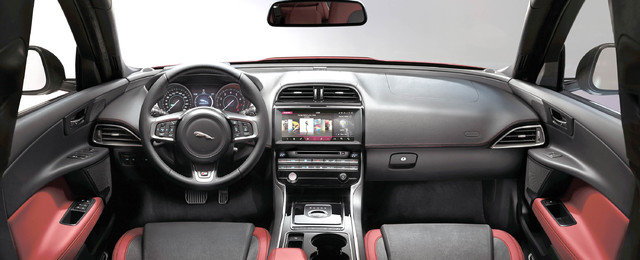 COURTESY JAGUAR The interior layout is neat and tidy with door tops that wrap around into the dash. The vents in the center stack are well camouflaged as part of the design.