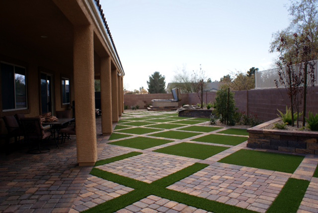 COURTESY  Landscaping yards with artificial grass and pavers make for a maintenance-free backyard that is also very attractive.