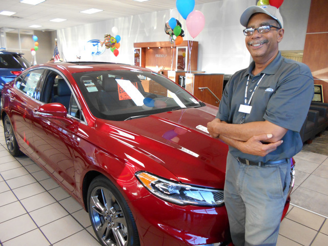 COURTESY Friendly Ford sales consultant Deryll Moore is seen with the peppy 2017 Ford Fusion Sport at the dealership situated at 660 N. Decatur Blvd.