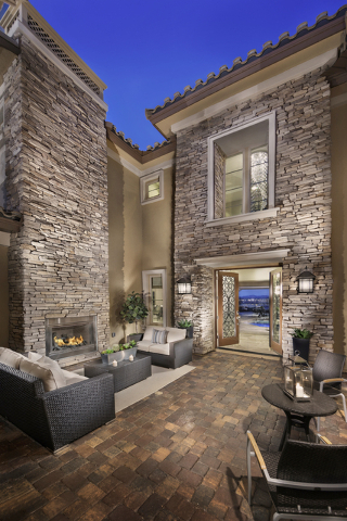 Lennar offers this home with a front courtyard that has a fireplace. (COURTESY OF LENNAR)