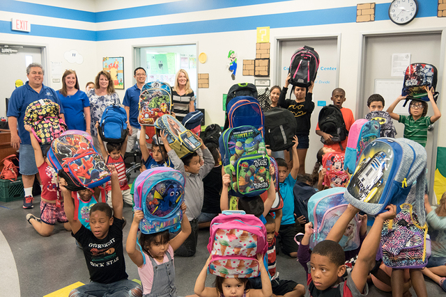 Local kids from the Boys & Girls Clubs of Southern Nevada receiving free backpacks this summer from GLVAR members. (Courtesy)