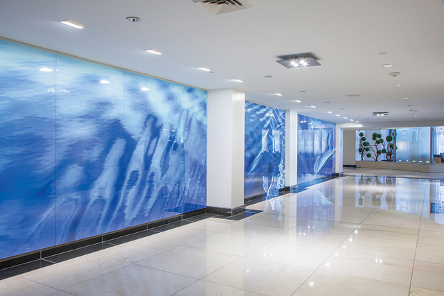 "One Las Vegas features a panoramic, 54-foot custom art installation called, ""Water Way"" in the entrance of the main tower, a masterpiece created by artist and photographer, Marilyn Suriani. Th ..."