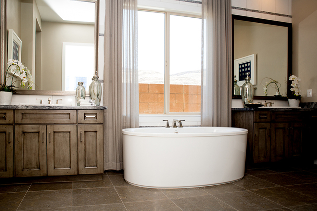 One of the master baths features a large soaking tub. (TONYA HARVEY/RJRealEstate.Vegas)