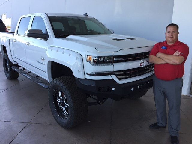 COURTESY Findlay Chevrolet sales consultant Newell Olmstead is seen with the 2017 Chevrolet Silverado truck that has been a popular choice of buyers since arriving about two months ago.