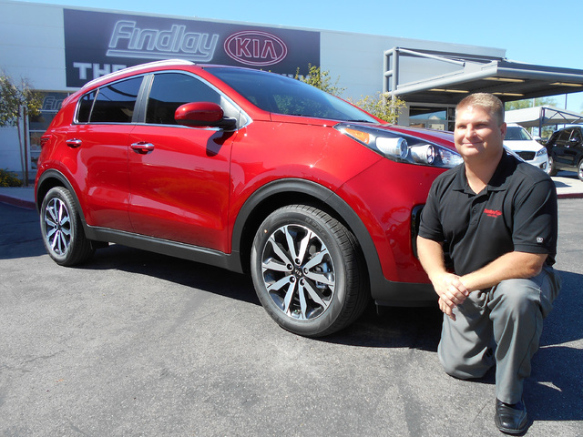 COURTESY Findlay Kia General Sales Manager Richard Cheskiewicz is seen with the newly designed 2017 Kia Sportage SUV, which has played a big part in an increase in sales at the dealership situated ...