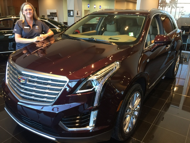 COURTESY Findlay Cadillac sales consultant Deb Topham is seen with the popular 2017 Cadillac XT5 Crossover at the dealership in the Valley Automall.