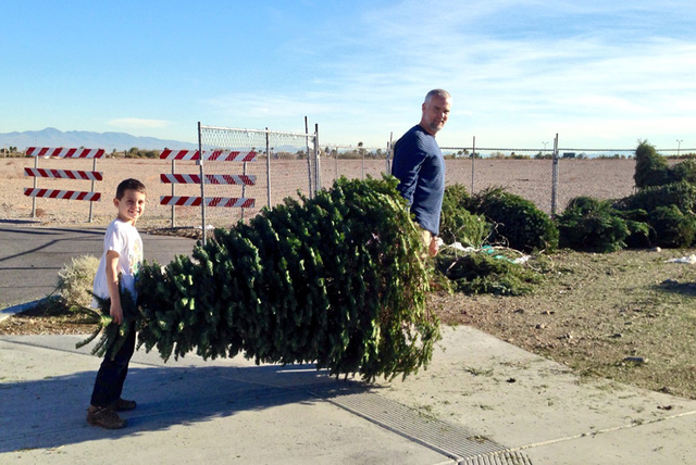Summerlin residents recycle their Christmas tree at the lot adjacent RC Willey Home Furnishings, 3850 S. Town Center Drive just south of the 215 Beltway, in Summerlin. This lot is one of 33 locati ...